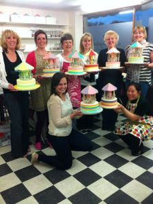 Picture of the class holding their carousel cakes