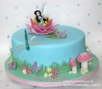 An image of Silvermist, a water fairy, on top of a fondant covered cakes